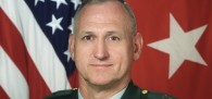 A war of words has erupted over a Kansas military base's decision to disinvite a highly decorated retired officer...