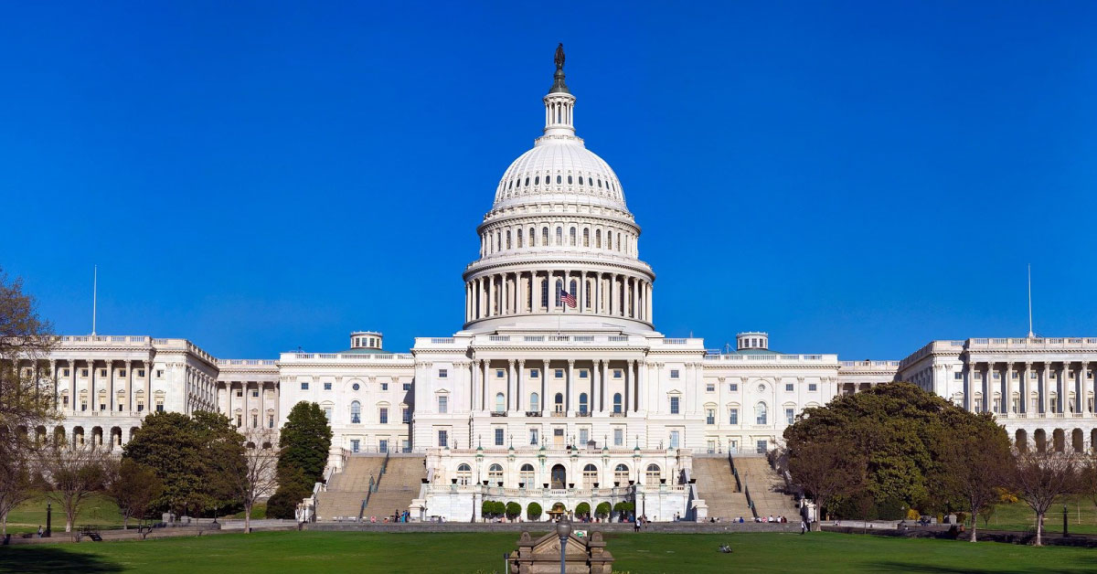 Wide view of Capitol Building against blue sky