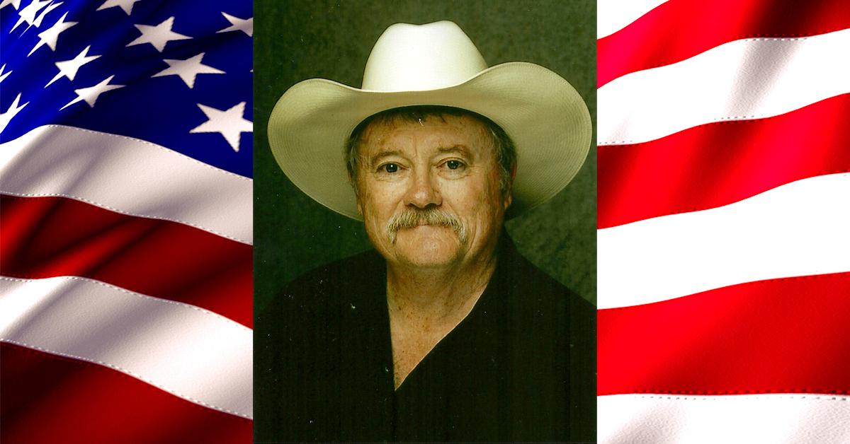 Headshot of John Compere on American Flag background