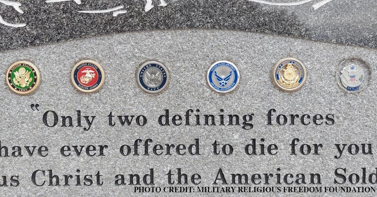 Close-up of illicit use of official military branch emblems on Christian memorial in violation of DoD regulations