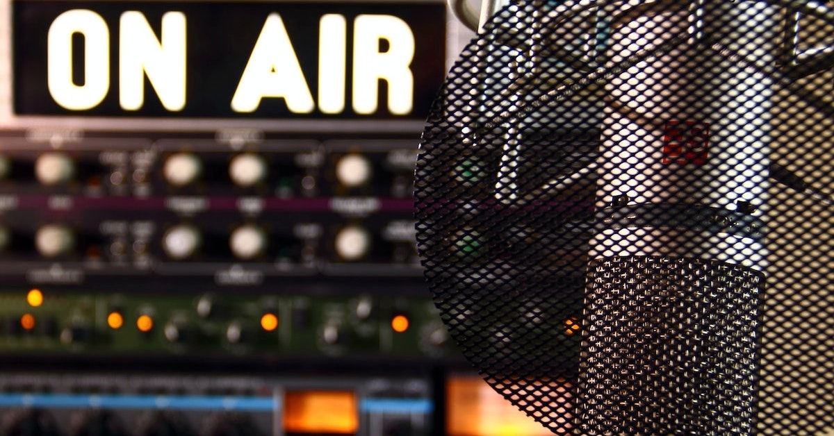 Radio microphone with on air sign in background